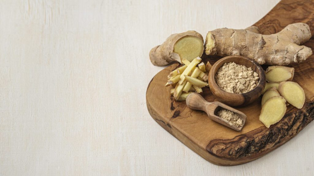 assortment-ginger-wooden-board-with-copy-space-1280x720