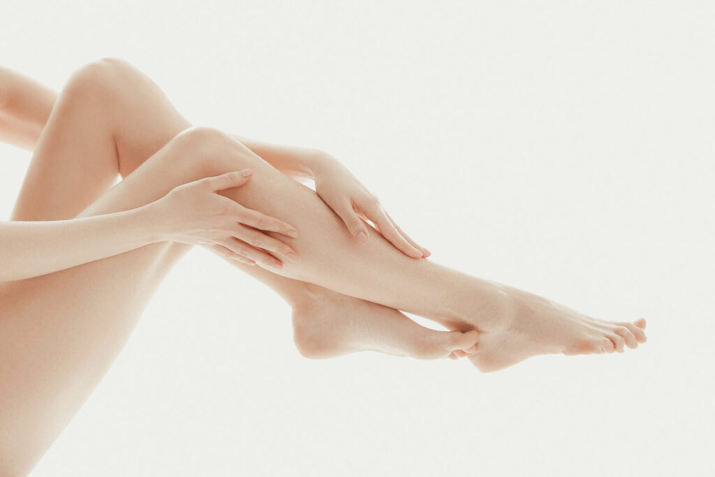 person-touching-her-legs-with-her-fingers-1536x1024
